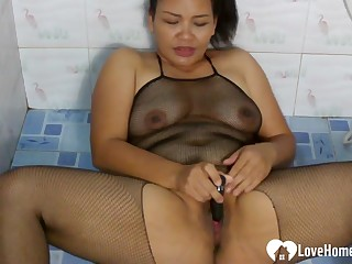 Beauty in a fishnet outfit pees plus cums