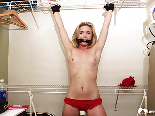 Tied-up and gagged beauty moans in pleasure