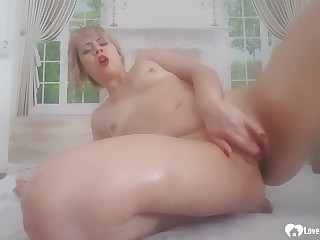 Naughty mature oils herself up before masturbating