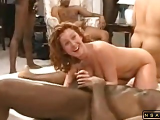 Wild amateur MILF babes surrounding interracial orgy with swarthy studs