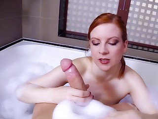 Hot redhead dazzles with her beast POV handjob
